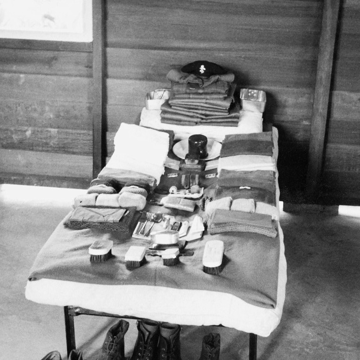 Kit laid out on a barrack bed ready for inspection, 1955