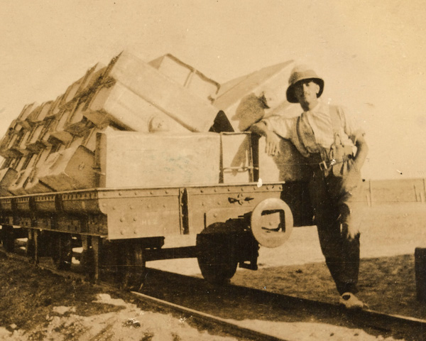 Joseph with a train truck of empty water tanks