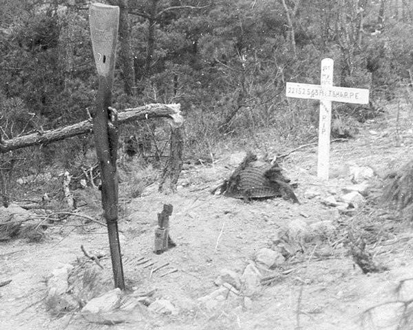 The grave of National Serviceman Private J Sharpe who was killed and buried where he fell on Middlesex Hill in Korea, 1950