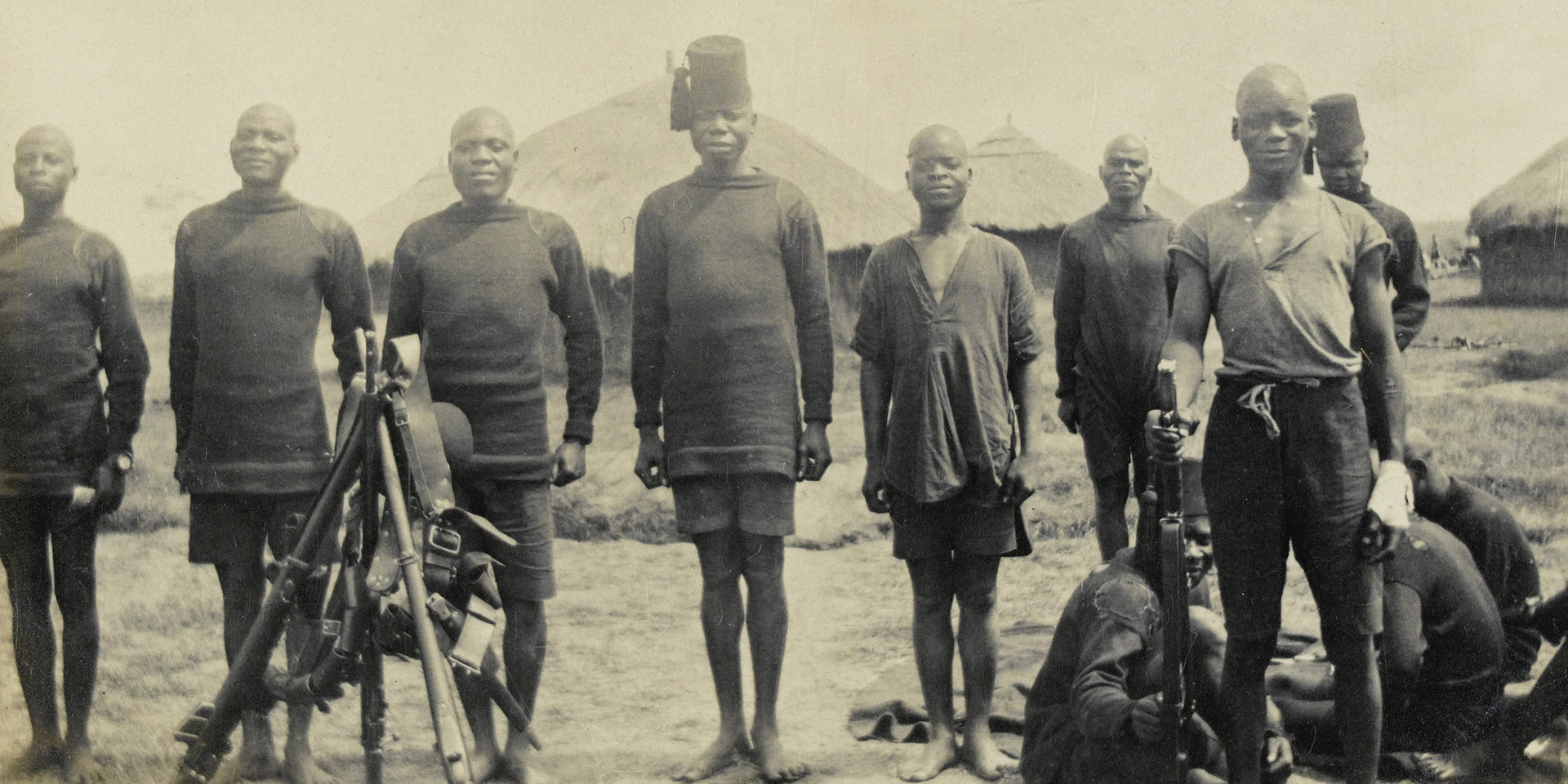 Men of the King's African Rifles pose for a photograph in camp