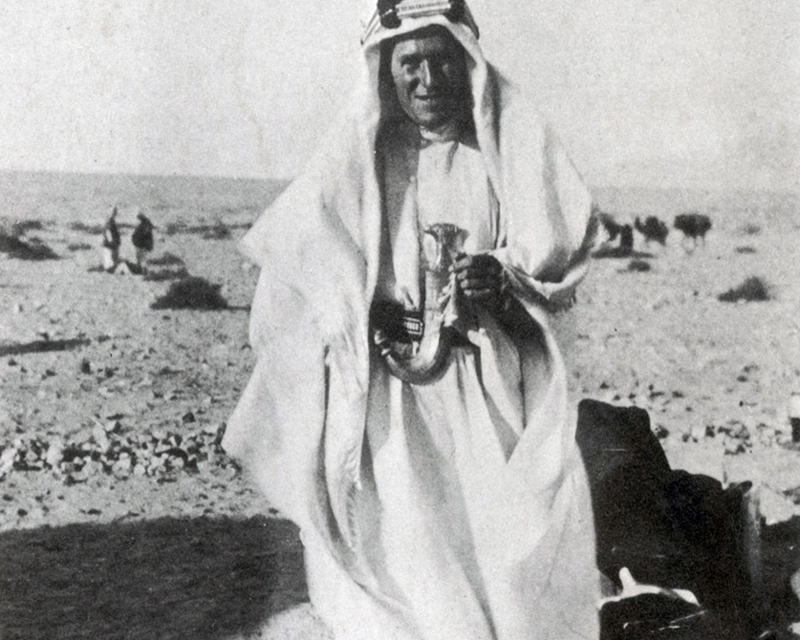 Lawrence in the desert in traditional Arab garb during the First World War