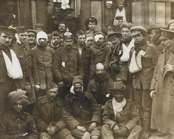 Wounded British, French and Indian soldiers at Neuve Chapelle, 1915.