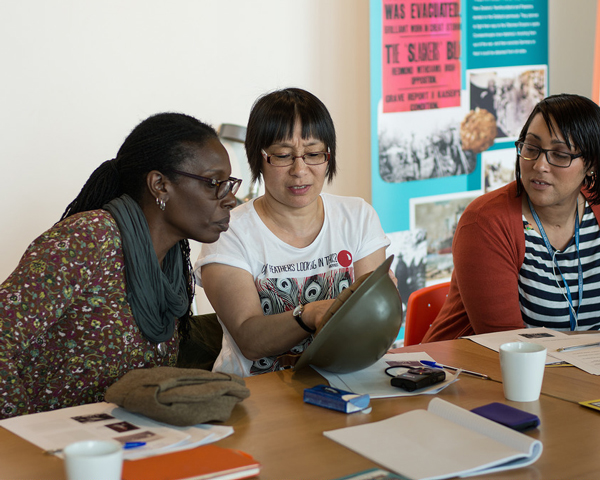 Workshop participants exploring objects relating to the history of West Indian soldiers