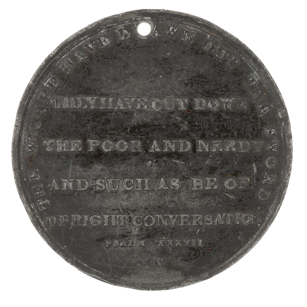 This medal, issued to commemorate the massacre, includes the dedication 'They have cut down the poor and needy and such as be of upright conversation'.