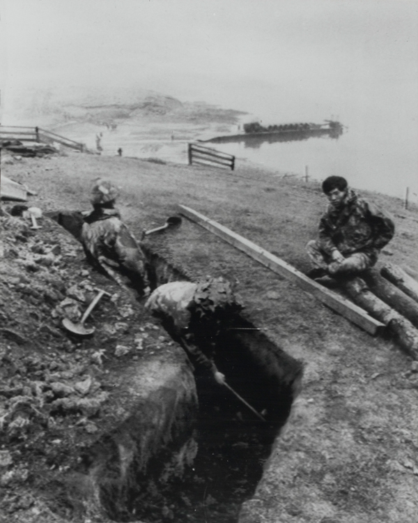 Men of 1st Battalion, 7th Gurkha Rifles, digging defensive positions on the shore of San Carlos Bay, Falkland Islands, 1982