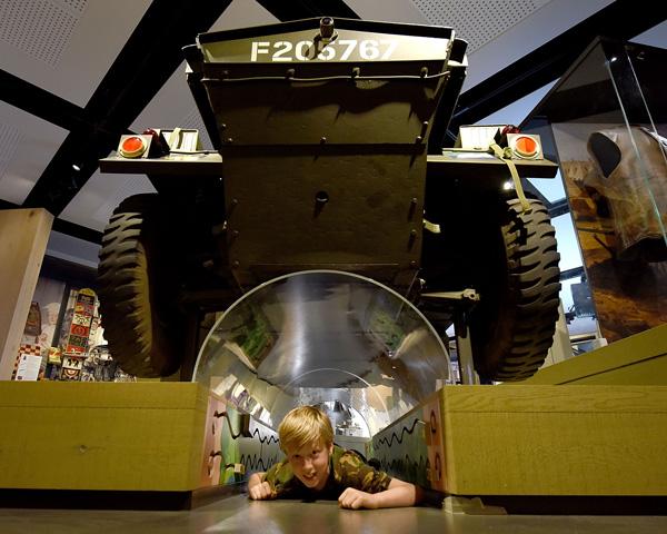 A child crawls through the dingo tunnel