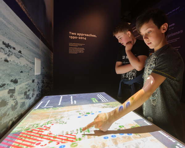 Children using an interactive mission table in Battle gallery