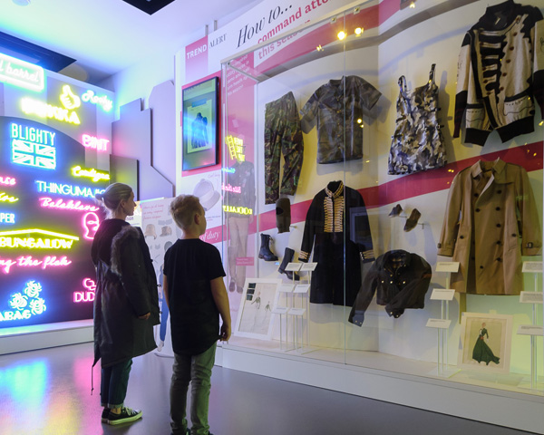 Visitors looking at the fashion wall in society gallery