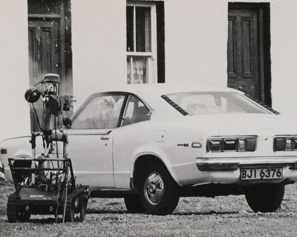 A Wheelbarrow robotic device approaches a suspected car bomb, Omagh, 1975