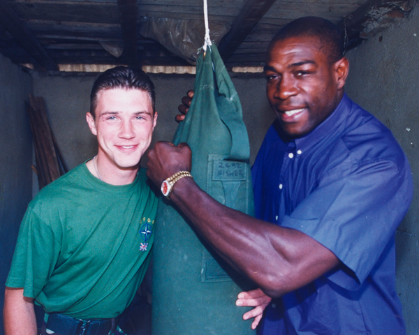 Frank Bruno meets Guardsman Patrick O'Keef, boxing champion of 1st Battalion The Irish Guards, Kosovo, 1999