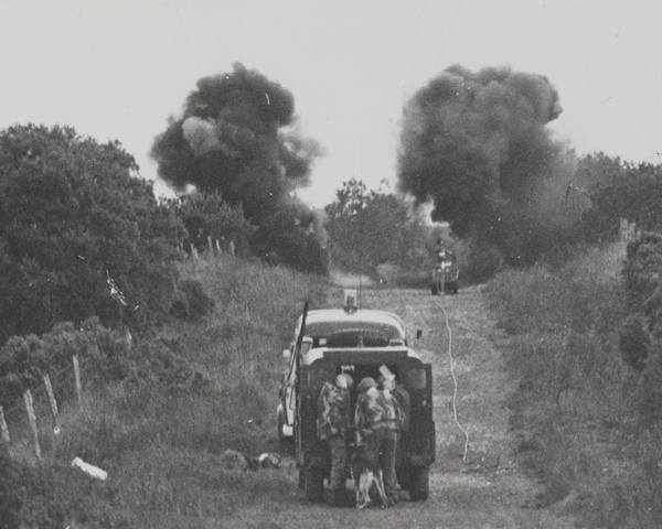 Army disposal officers detonate a device near the Irish border, 1975