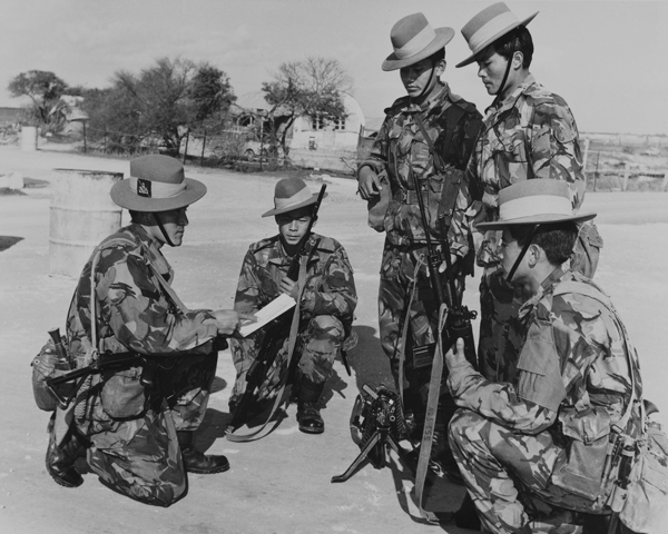 Gurkhas being briefed before moving out on patrol at the British Sovereign Base of Dhekelia, 1974