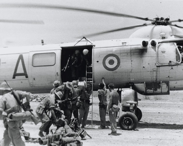 Disembarking from a Bristol Belvedere helicopter in Radfan, 1964