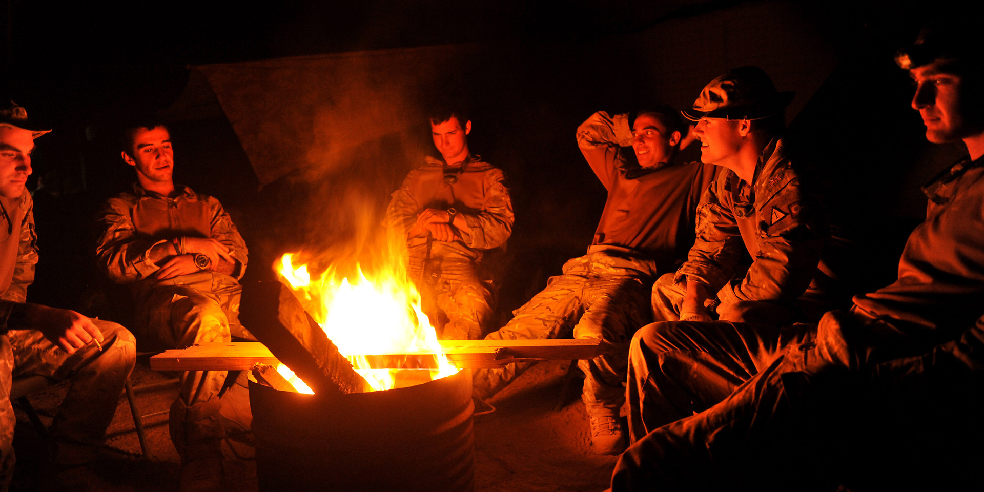Soldiers round a fire