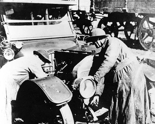 QMAAC mechanics repair a car, 1918