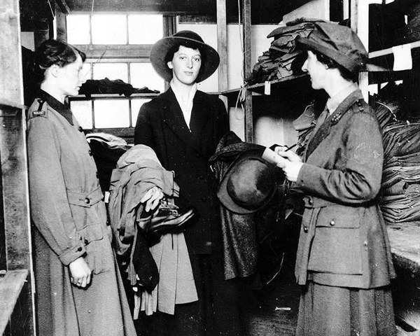 A WAAC recruit collects her uniform, 1917
