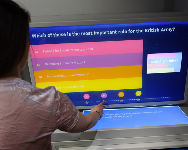 A visitor interacts with a survey screen