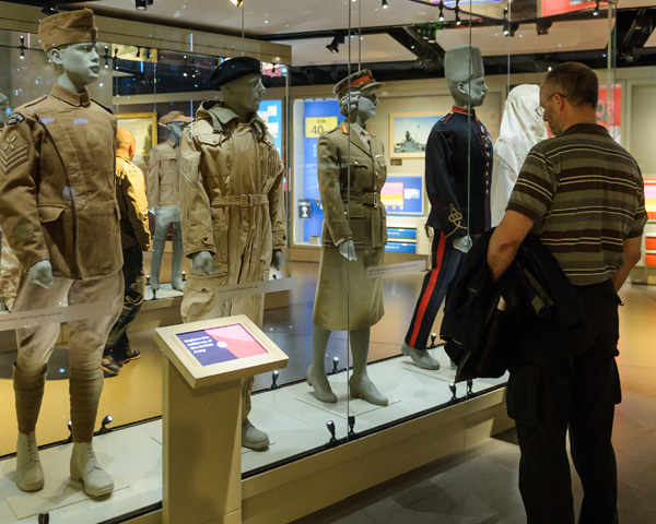 A visitor looks at uniforms in Army gallery