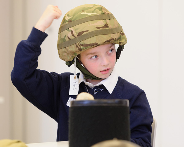 School boy trying on helmets