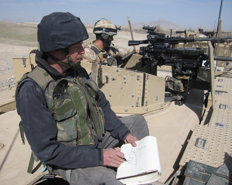 Jules George sketching in Afghanistan in 2010