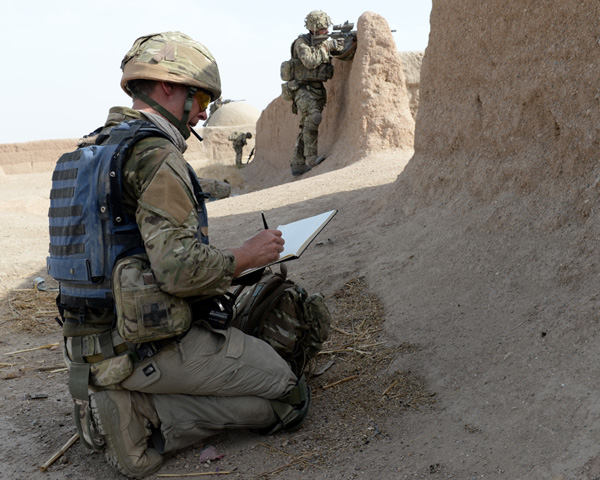 Matthew Cook sketching in Afghanistan