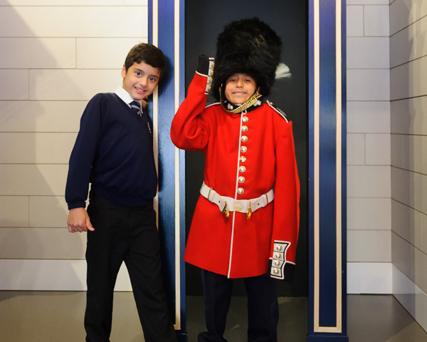 Children dressed up in guardsman's uniform