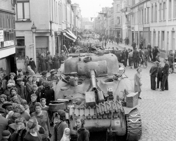 Civilians crowd around 3rd/4th County of London Yeomanry (Sharpshooters) tanks, Antwerp, 7 September 1944