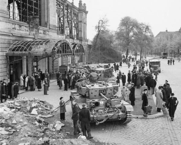 German civilians gather around British tanks in occupied Hamburg, 5 May 1945