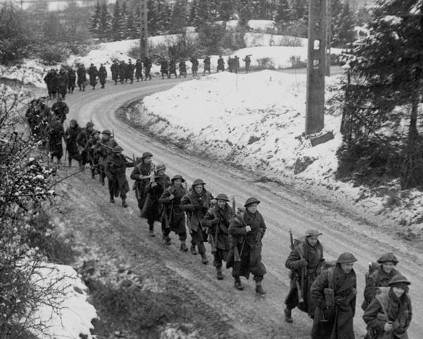 British infantry advance through the snow, Ardennes, December 1944