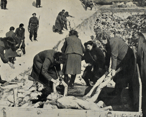 Female SS guards bury their victims at Belsen, April 1945