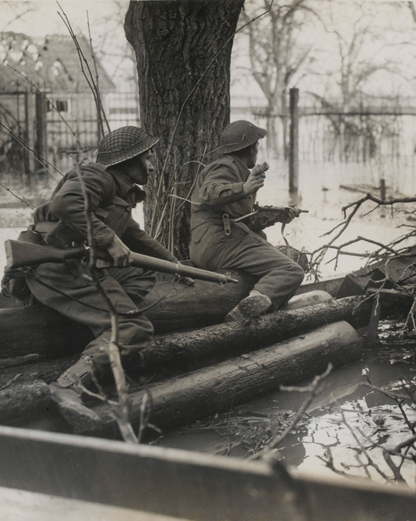 British infantry in action among the floods at Elst, south of Arnhem, 1944