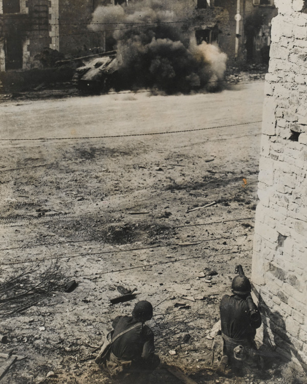 An American bazooka knocks out a German tank, September 1944