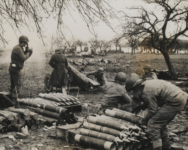 105mm field guns firing at German positions on the 3rd US Army front, 1944