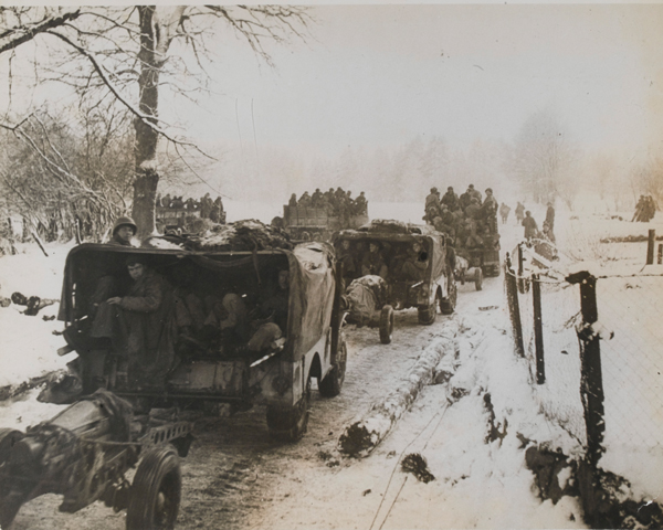 Reinforcements from the US 1st Army pass through Fosee in the Ardennes, December 1944
