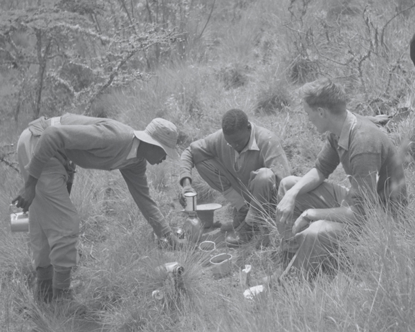 A British officer and men of the 4th King's African Rifles brew up in the bush, 1950s