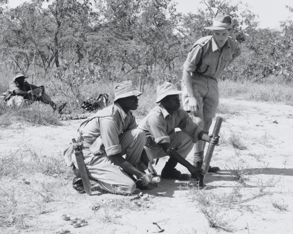 Training with a light mortar in the Kenyan bush, 1956