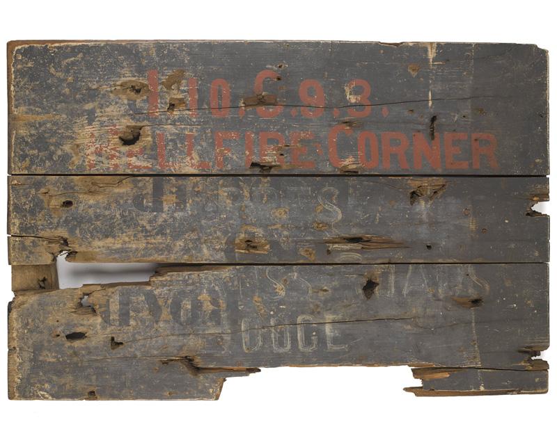 A wooden signboard taken from Hellfire Corner near Ypres