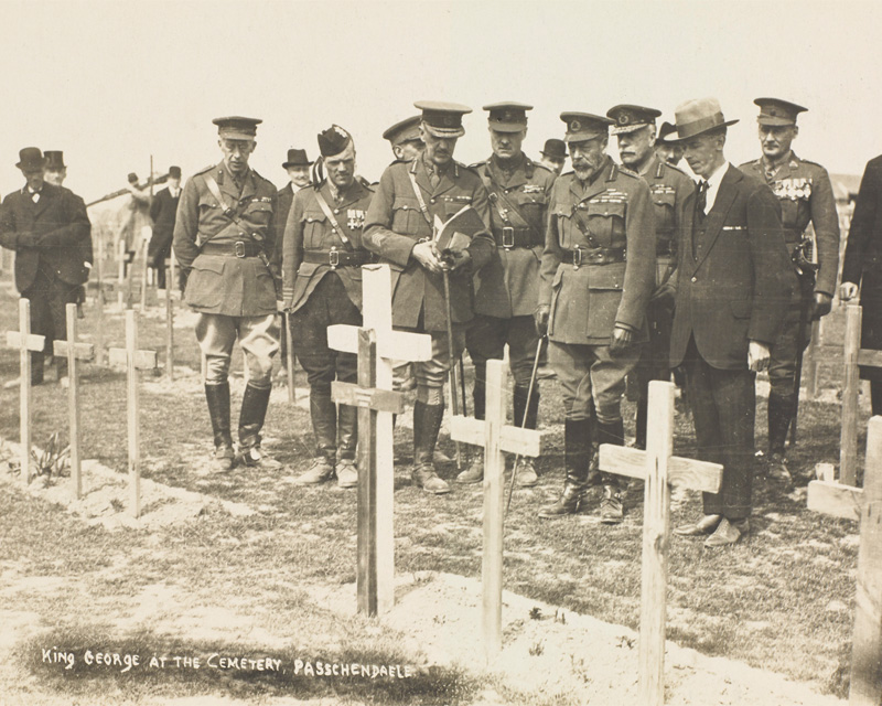 King George V inspects the graves of those killed during the Battle of Passchendaele in the cemetery at Tyne Cot during his visit to the battlefields of France and Belgium in 1922