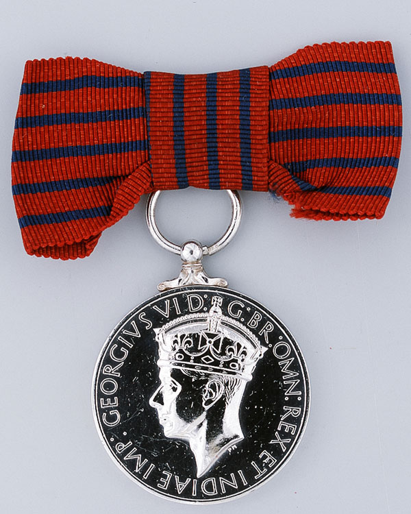 George Medal awarded to Margaret Richards of the ATS who risked her life giving first aid to soldiers wounded in an ammunition depot explosion, 1948
