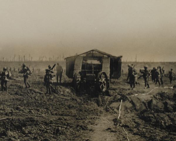 British infantry advance alongside a Mark I tank, 1916