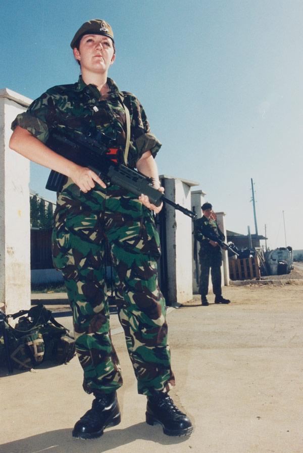 Private Leanne Jordan guarding the British Force Headquarters main gate, Kosovo, 1999