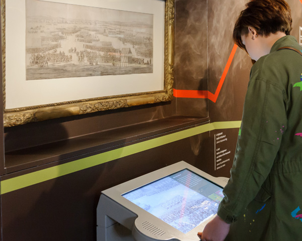 A visitor using the Hounslow Heath interactive