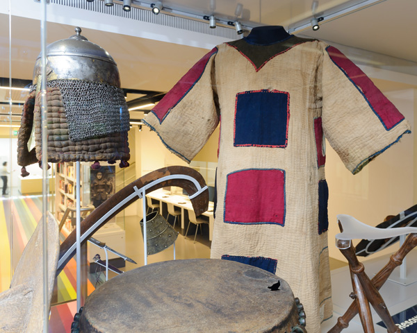 A jibbah or tunic on display with other objects relating to Egypt and Sudan