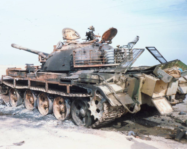 A destroyed Iraqi T-55 tank in the Kuwait desert, 1991