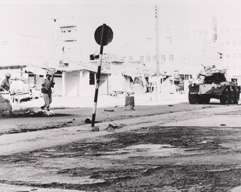An armoured car patrols the Aden streets during a riot, 1967