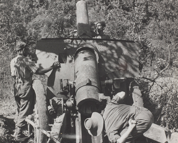 Inspecting a Japanese 105mm gun abandoned on the Tiddim Road near Imphal, 1944