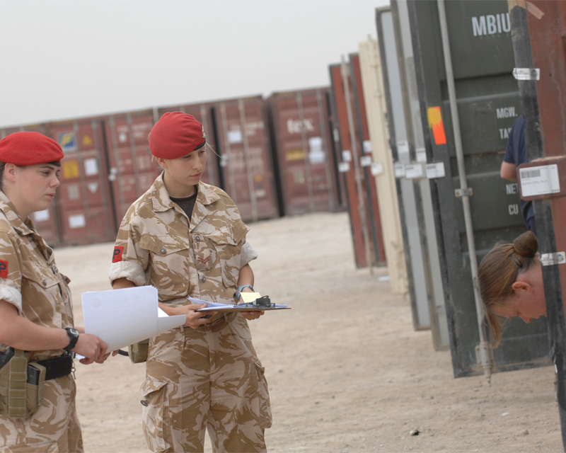 Royal Military Police personnel inspect shipping containers in Iraq, 2005