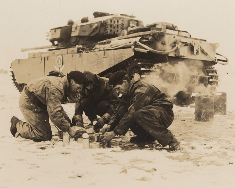 A tank crew from the 8th (King's Royal Irish) Hussars make a meal during their service on the Imjin, 1951