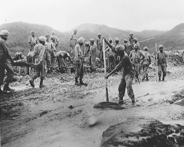Bengal Sappers and Miners repairing the Palel-Tamu Road, Imphal, 1944