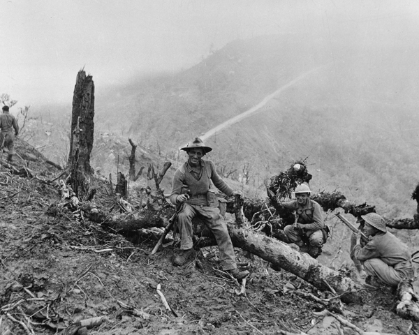 Members of the 10th Gurkha Rifles resting after the capture of 'Scraggy' hill, Imphal, 1944